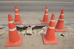 Traffic cone  used on concrete pavement . Stock Photos