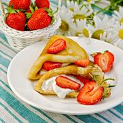 Pancakes with strawberries on a napkin Stock Photos