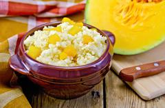 porridge millet with pumpkin and knife - stock photo