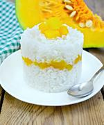 rice with pumpkin on board - stock photo