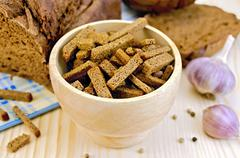 rye homemade bread with croutons in a bowl - stock photo