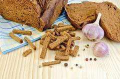 rye homemade bread with croutons on the board - stock photo