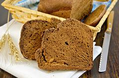 rye homemade bread with ears on board - stock photo