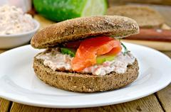 sandwich with cream and salmon on the board - stock photo