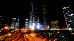 Pudong District at night in Shanghai, China Stock Footage