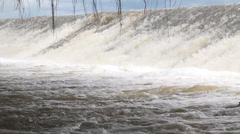 Flood, Water flow over road. - stock footage