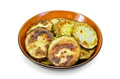 Zucchini fried in ceramic ware Stock Photos