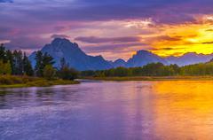 beautiful sunset at grant tetons - stock photo