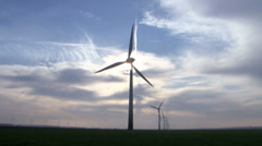 A wind turbine or wind power plant is a device that converts kinetic energy from Stock Footage