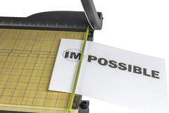 making impossible possible paper cutter - stock photo