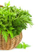 collection of fresh spicy herbs in basket / isolated / vertical - stock photo