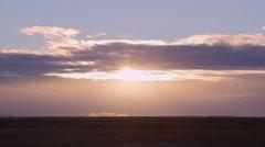 Cloudy sunrise Timelapse prairie Stock Footage
