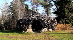 Witch house hut found in the middle of trees and some rocks Stock Footage