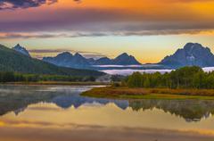 Grand teton reflection at sunrise Stock Photos