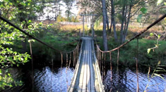 Walking steadily on the hanging bridge Stock Footage