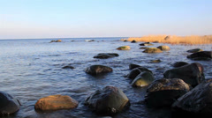 Water near the seashore is constantly moving on the rocks Stock Footage