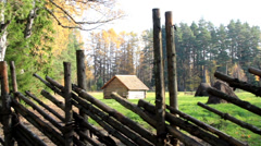 Closer image of the cabin log within the fence Stock Footage