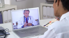 Stock Video Footage of Doctor holding video conference with colleague