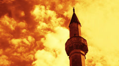 Timelapse of clouds passing by over minaret of mosque Stock Footage