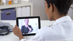Senior patient video chatting with doctor on ipad Stock Footage
