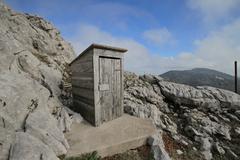 outdoor toilet on mountain - stock photo