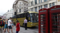 London British Red Telephone Box Busy City Car Traffic People Walking Rush Hour Footage