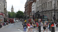 Double Decker Bus People Passing Iconic Trafalgar Square London UK Big Ben Tower Footage