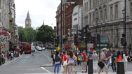 Double Decker Bus People Passing Iconic Trafalgar Square London UK Big Ben Tower Stock Footage