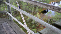 758 overhead view of the people walking on the wooden trail on bog swamp - stock footage