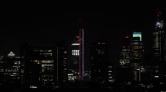 Illuminated Night Light Aerial View London City Skyline High Rise Buildings - stock footage