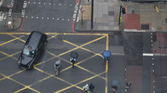 London Traditional Black Taxi Cab Passing People Crossing Crosswalk Rainy Day UK Stock Footage