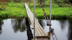 784 hanging bridge and flowing water Stock Footage