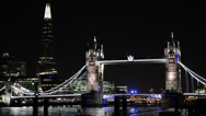 Stock Video Footage of Ambulance Car Passing Tower Bridge Illuminated London Shard Thames River Night