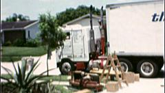 MOVING VAN DAY Relocating Family 1970s Vintage 8mm Film Home Movie 7312 - stock footage