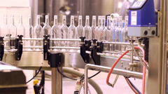 Wine bottles about to be filled at the plant Stock Footage