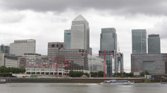 Corporate Building Canary Wharf London Skyline UK Business Downtown Boat Passing Stock Footage