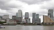 Stock Video Footage of London Canary Wharf Skyline Financial District British Transport Boat Passing UK