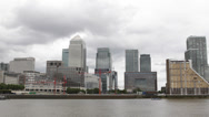Stock Video Footage of London Financial Hub Canary Wharf Skyline Thames River Corporate Headquarters UK