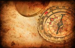 navigation compass on grunge old paper texture - stock photo