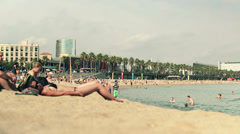 EDITORIAL People on barceloneta beach in Barcelona HD Stock Footage