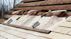 unfinished cedar wooden shingle shake roofing repair - stock footage