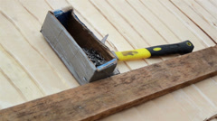 888 box of nails and hammer at the unfinished cedar wooden shingle shake roof Stock Footage