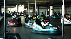 EDITORIAL People riding electric bumper cars in Tibidabo amusement park HD Stock Footage