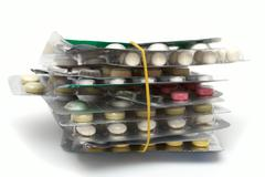 batch of pills packages - stock photo