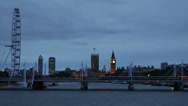 Stock Video Footage of London Eye Hungerford Bridge Big Ben Tower Parliament House Illuminated Night