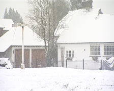 Offham village green in snow Quintain village sign Stock Footage