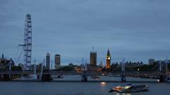 London Skyline Twilight Ferris Wheel Eye County Hall Hungerford Bridge Big Ben  Stock Footage