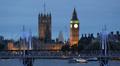 Parliament London Skyline Boat Passing Golden Jubilee Walkways Illuminated Night Footage