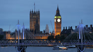 Stock Video Footage of Parliament London Skyline Boat Passing Golden Jubilee Walkways Illuminated Night