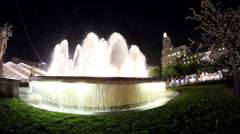 Big fountain with white lights Stock Footage